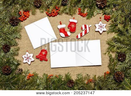 Christmas framework with evergreen fir tree cones holly berry and card for text