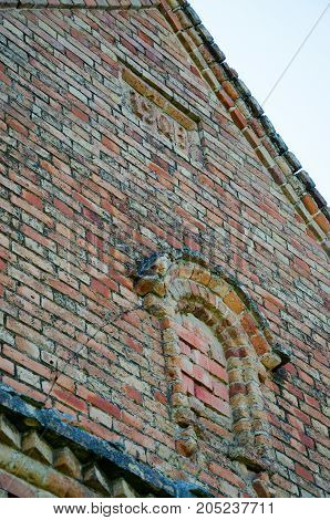 part of the brick wall of the building