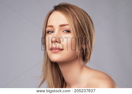 Young caucasian woman with perfect skin clean. Posing for beauty portrait.