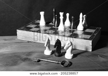 white and black chess pieces on the board