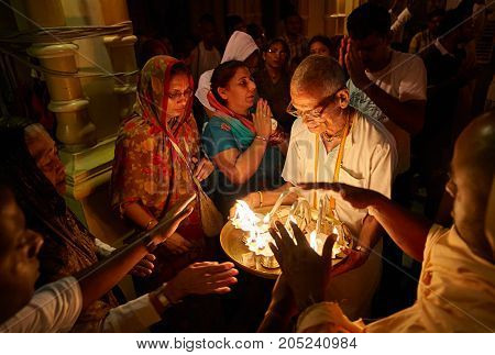 People Getting Blessings From The Holy Fire