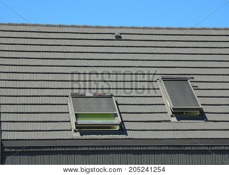 Energy Efficiency New Passive House Building Concept. Dormers, Skylights Ventilation and Air Conditioning Systems Installed on Tiled House Roof