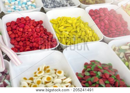 Candy stand with gummi colorful candy close up