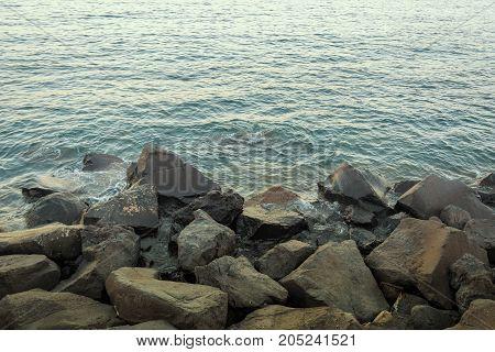Calm sea water on a rocky coastline