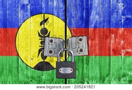 New Caledonia flag on door with padlock