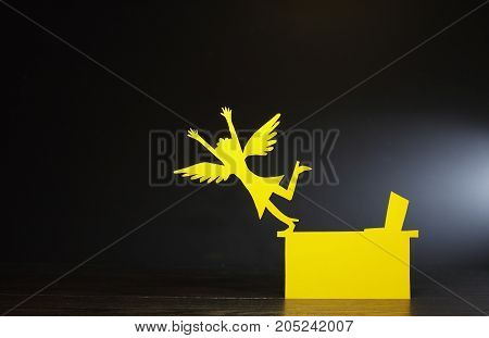 Woman takes off the office table with her wings. Vacation concept