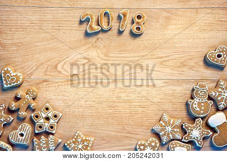Merry Christmas and Happy new year! Homemade cookies on wooden background. Copy space for your text. Top view. High resolution product