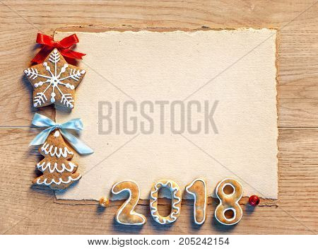 Christmas card with gingerbread cookies 2018. Merry Christmas and Happy New Year!! Copy space for your text. Top view. High resolution product