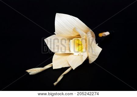 Kind of wood flower isolated on black background; to be placed on the site of cremation in Thailand. (Dok Mai Jan)