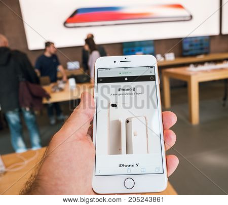 PARIS FRANCE - SEP 22 2017: New iPhone 8 and iPhone 8 Plus as well the updated Apple Watch Apple TV goes on sale today in Apple Store with customer POV on the iPhone 8 site