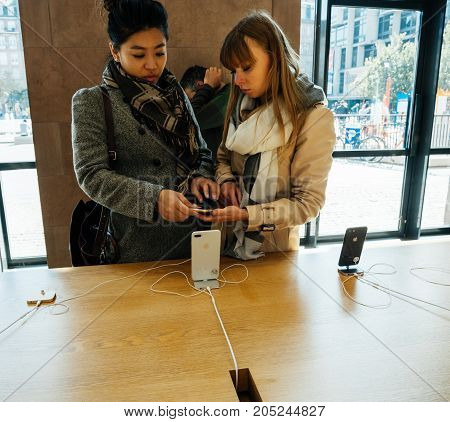 New Iphone 8 And Iphone 8 Plus In Apple Store With Girls Choosing Phone,