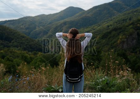 A young girl is traveling in the mountains. Part 3.