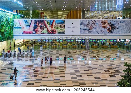 Visitors Walk Around Arrival Hall Immigration Area In Changi Airport
