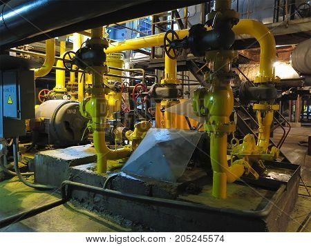 Oil Pump, Yellow Pipes, Tubes, Machinery At Power Plant