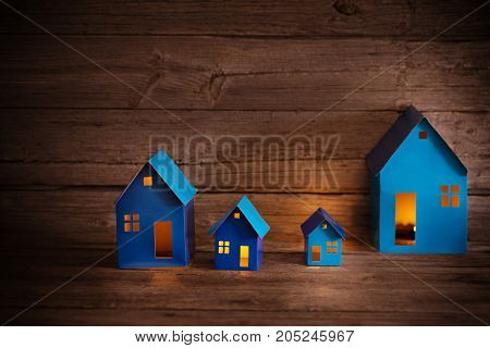 the blue aper houses on wooden background