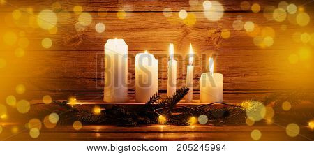 the Christmas candles on dark wooden background