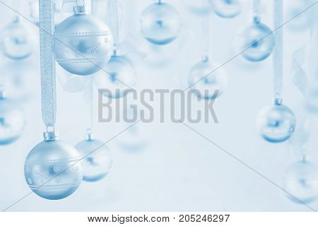 the blue Christmas balls on blue background