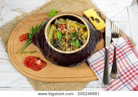 Potatoes in clay pots. Potato with bacon. Potatoes and vegetables.