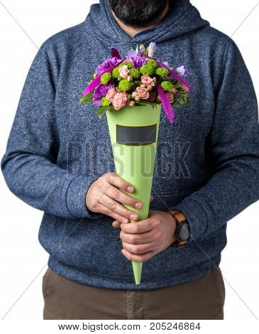 man holds bouquet of different flowers. Valentine's Day