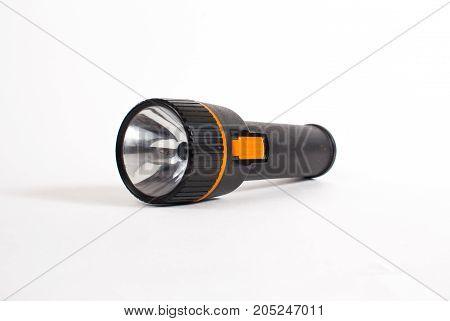 old black flashlight isolated on white background