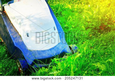 work lawnmower mowing green grass yard service