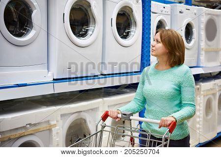 Woman Housewife Whit Shopping Cart Shopping For Washing Machine