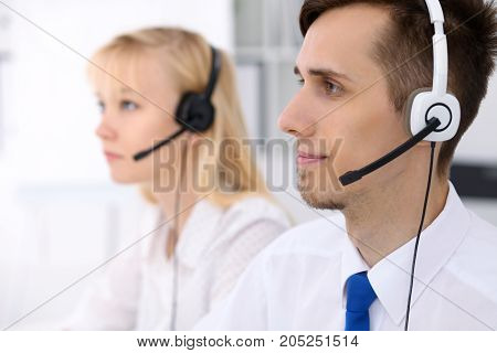 Young businessman in headset. Call center operator or consulting staff
