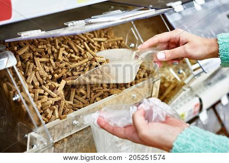 Buyer In Shop Buys Bread Crackers Using Scoop For Products