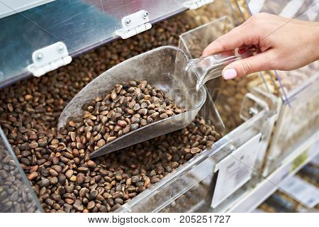Buyer With Scoop Takes Pine Nuts In Store