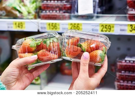 Strawberries In Hands Of Buyer At Store