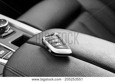 Sankt-Petersburg, Russia, March 05, 2017 - Close up of keys of BMW X5M 2017 in black leather car interior, car interior details. Black and white