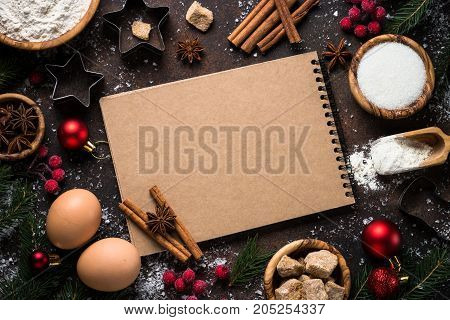 Christmas Baking background. Ingredients for cooking christmas baking on dark rustic background. Top view with copy space.