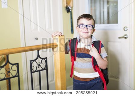 A Cute 6 year old Caucasian boy inside home preschool