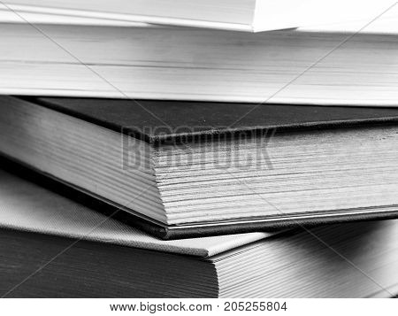 close up of a pile of books. black and white. culture. education.