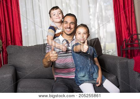 A Portrait of single daddy with 2 kids at home