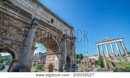 Arch of Septimius Severus and aspects from inside the Roman Forum. Rome Italy.