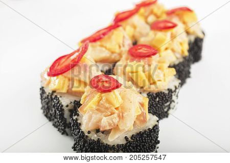 close up traditional japanese seafood sushi rolls with tobica eel and pepper on white background