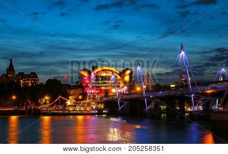 The Charing Cross station and Hungerford Bridge by the River Thames, London, United Kingdom.