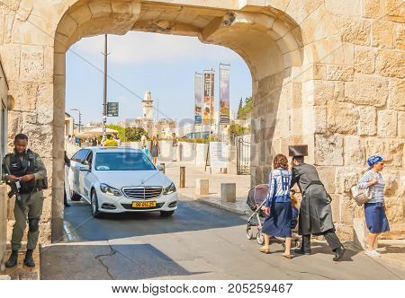JERUSALEM, ISRAEL. September 15, 2017. A taxi cab leaving the Old city of Jerusalem through the Dung gate. Tight security and religious pilgrims going to the Western wall to pray.