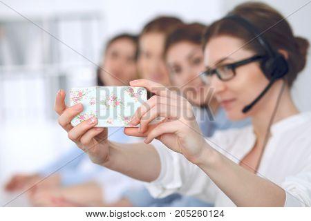 Call center operators make selfies. Business concept