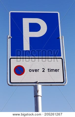 Norwegian car parking sign allowed parking time 2 hours on blue sky.