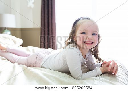 a girl lay on bed at home