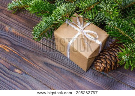 Gifts under christmas tree over wooden floor. Top view with copy space.
