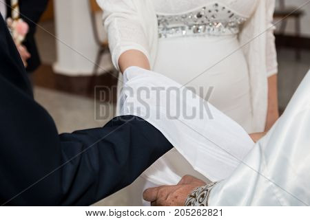 Wedding ceremony in orthodox church traditional handfasting