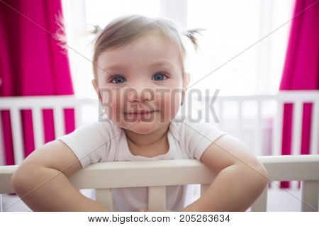 A Cute little girl in cradle at baby room