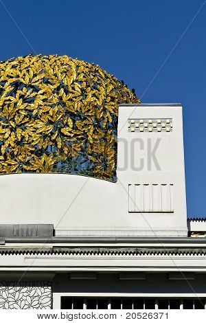 A golden cupola of laurels on an aged building in Vienna Austria poster