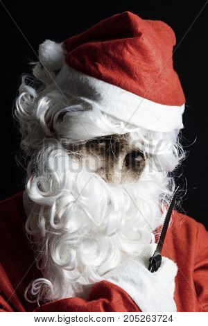 portrait of spooky looking santa claus with knife in hand