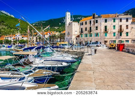 Scenic view at marble picturesque place Komiza on Island Vis during summertime, famous travel resort in Croatia, Europe.