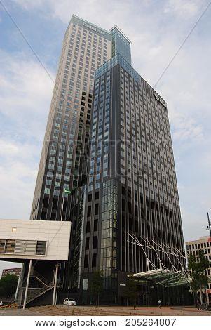 Rotterdam, The Netherlands - July 27, 2014. MaasToren on the bank of Nieuwe Maas river in Kop van Zuid neighborgood of Rotterdam, is the tallest building in The Netherlands.