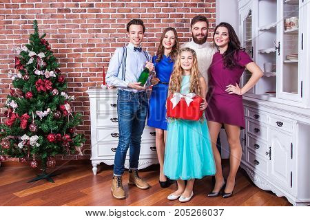 Portrait Beautiful Family In Christmas Vacantions. Holding Champaign And Red Gift Box.